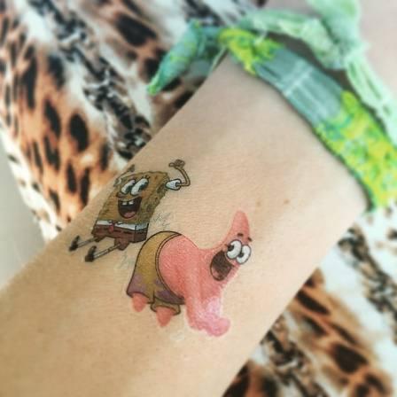 Thalia-faz-tatuagens-2